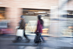 People walking in shopping centre,  zoom effect, motion Royalty Free Stock Photos