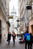 People walking and shopping at historical shopping street in center of Salzburg Royalty Free Stock Photo