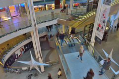 People walking in a shopping mall Stock Images