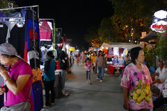 People walking and shopping at the night market Stock Image