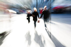 People walking on shopping street with zoom effect Royalty Free Stock Images
