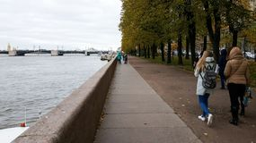 People walking on the side of river Neva in St. Petersburg, Russia stock image