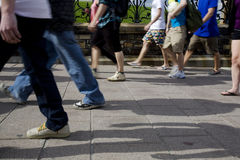 People Walking on the Sidewalk Royalty Free Stock Photography