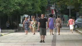 People walking on the sidewalk in the center of Varna, Bulgaria stock video footage