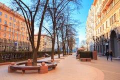 People walking on the sidewalk on Lenin Street in spring in Mins Stock Images