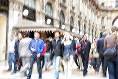 People walking on sidewalk Stock Photography