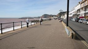 People walking Sidmouth promenade seafront Devon with sound stock video
