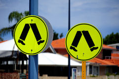 People walking safety sign post Stock Photo