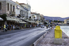 People walking and sitting on the coastline of Chios island Royalty Free Stock Photography