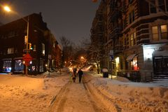 People walking in the snow blizzard in Manhattan New York royalty free stock photos