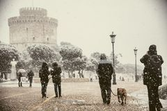 People walking in the snow in the center of the city on a winter day. At Thessaloniki stock images