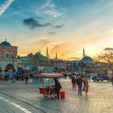 People are walking at square in Eminonu in front of Egyptian Spice Bazaar royalty free stock photo