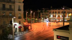 People walking on a square at night in Montpellier, France. People walking on a square at night in Montpellier, Herault in the south of the France stock video footage