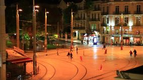 People walking on a square at night in Montpellier, France. People walking on a square at night in Montpellier, Herault in the south of the France stock video