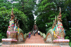 People walking at stairs entrance to Wat Phra That Doi Suthep Stock Image