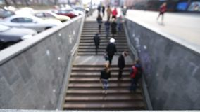 People walking on stairs to underground crossing stock footage