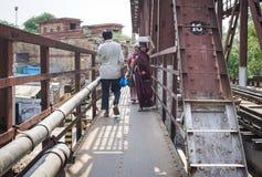 People walking on the steel bridge in Varanasi, India Royalty Free Stock Images
