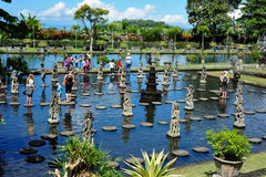People walking on the stones in Tirtagangga Water Palace Stock Photo