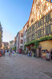 People walking on a street in Alsace Stock Image
