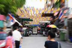People walking on street in Bangkok city with Zoom motion Blur effect Stock Image