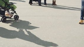 People Walking on the Street on a Bright Sunny Winter Day, Shadows on the Pavement. stock footage