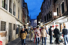 People walking in the street called `Rio Tera Lista di Espagna` at dusk Stock Photo