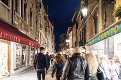 People walking in the street called `Rio Tera Lista di Espagna` at dusk Royalty Free Stock Photography
