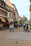 People walking on a street in Colmar Royalty Free Stock Image