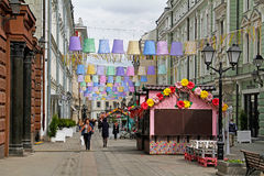 People walking at street festival `Moscow Spring` in Stoleshnikov Lane in Moscow Stock Photo