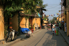 People are walking in a street of Hoi An (Vietnam) Stock Photos