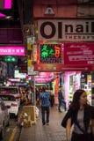People walking at a street in Hong Kong at night Royalty Free Stock Photos