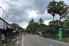 People walking on street in Jogja, Indonesia.  Royalty Free Stock Image