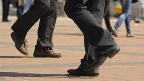 People walking on the street, legs stock video