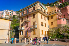 People walking on the street of Manarola village in Italy. MANAROLA, ITALY - APRIL 11, 2015: People walking on the street of Manarola village in Italy. Manarola Royalty Free Stock Images