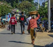 People walking on street in Mandalay, Myanmar stock photography
