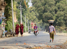 People walking on street at Mingun village in Mandalay, Myanmar Stock Photos