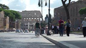 People Walking on a Street near Colosseum in Rome