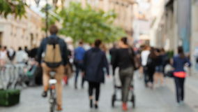 People walking on the street, not in focus. Slow motion stock footage