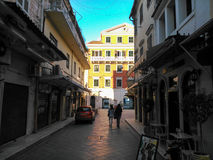People walking in a street of old town of Corfu island Greece. Winter In  the afternoon Royalty Free Stock Images