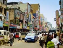 People walking on a street of Pettah neighborhood, Colombo, Sri. Lanka Royalty Free Stock Photos