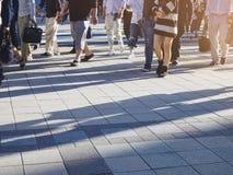 People walking on Street sidewalk Urban City stock photos