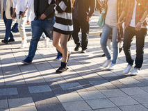 People walking on Street sidewalk Urban City royalty free stock photography