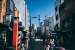 Tokyo Skytree at Asakusa area in Tokyo, Japan. People walking on street to the direction of Tokyo Skytree at Asakusa area, Japan stock photos