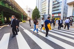 People walking on the street of Tokyo Ginza District. Ginza is one of the most luxurious shopping Stock Image