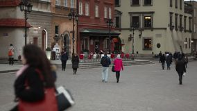 People walking on the street of Warsaw. Pedestrians in Europe. Full HD footage. Streets of Warsaw. Evening on the Old Town stock video footage