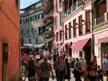 People walking in the streets of the ancient village at festival of strawberry in Nemi Italy Stock Images