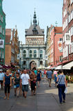 People walking on streets in historical center. Gdansk Stock Images