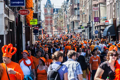 People walking in the streets - Koninginnedag 2012 royalty free stock photos