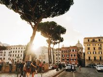 People walking on streets Rome by evening in sunset. Rome, Italy - October 22, 2017: people walking on streets Rome by evening in sunset Stock Images