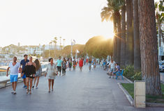 People walking in a summer afternoon in Cannes Stock Photography